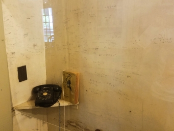 Connected to the pantry, Faulkner scribbled contact's phone numbers onto the wall behind the home's telephone.